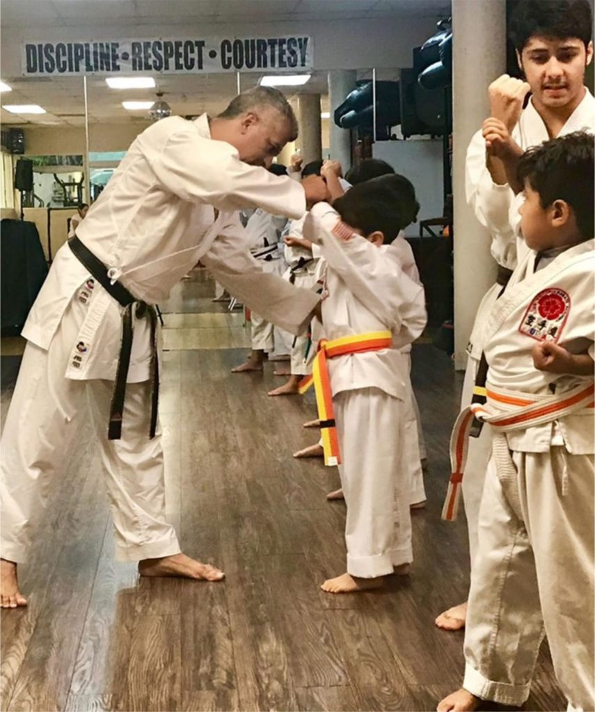 Mr. Victoria teaching Karate to children in his karate school in the South West of Miami